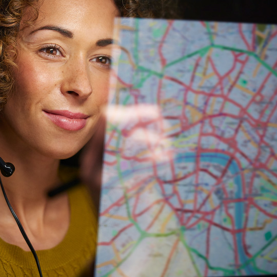 woman looking at gis mapping system